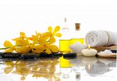 stock photo of yellow orchid  - Spa feeling with Orchid and burn candles  - JPG