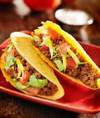 picture of shredded cheese  - two beef tacos with cheese - JPG