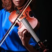 picture of violin  - Violin playing violinist musician. Woman classical musical instrument player on black