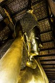 stock photo of recliner  - Reclining Buddha statue in Thailand Buddha Temple Wat Pho  - JPG