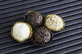 image of sweetie  - Brazilian sweeties on a black table - JPG
