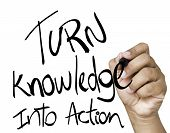 stock photo of empower  - Turn Knowledge into action written on wipe board  - JPG