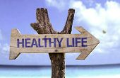 foto of ayurveda  - Healthy Life wooden sign with a beach on background  - JPG