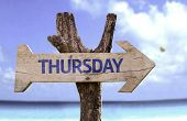 stock photo of thursday  - Thursday wooden sign with a beach on background  - JPG
