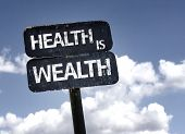 stock photo of mental_health  - Health is Wealth sign with clouds and sky background  - JPG