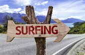 stock photo of watersports  - Surfing wooden sign with a street background  - JPG
