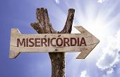 "stock photo of condolence  - ""Misericordia"" (In portuguese: Mercy) sign with a beautiful day on background  - JPG"