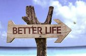 image of prosperity sign  - Better Life wooden sign with a beach on background  - JPG