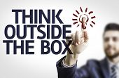 picture of thinking outside box  - Business man pointing to transparent board with text - JPG