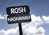pic of tora  - Rosh Hashanah sign with clouds and sky background  - JPG