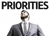 stock photo of priorities  - Business man with the text Priorities in a concept image - JPG