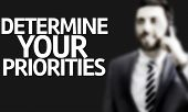 stock photo of priorities  - Business man with the text Determine your Priorities in a concept image - JPG