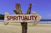 stock photo of spiritual  - Spirituality wooden sign with a beach on background - JPG