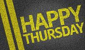 stock photo of thursday  - Happy Thursday written on the road - JPG