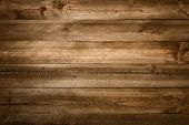 stock photo of studio  - Perfect wood planks background with nice studio lighting and beautiful vignetting to draw the eyes into the picture - JPG
