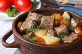 stock photo of stew pot  - beef stew with vegetables in a pot close up - JPG