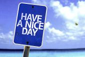 stock photo of special day  - Have a Nice Day sign with a beach on background - JPG