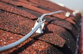 foto of lightning-rod  - Lightning conductor rod on the roof close up - JPG