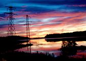 picture of power lines  - Power lines with a Bald Eagles nest built on top of it - JPG