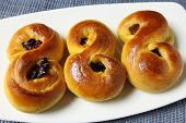 stock photo of saffron  - Sweet Swedish buns baked with saffron cranberries and raisins - JPG