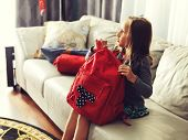 stock photo of little school girl  - little girl ready for school at home with school bag - JPG