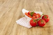 stock photo of household farm  - bowl of tomatoes on the wooden table - JPG