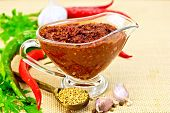 pic of fenugreek  - Tabasco adjika in a glass gravy boat - JPG