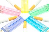 stock photo of cigarette lighter  - colorful lighters and few cigarettes closeup on white - JPG