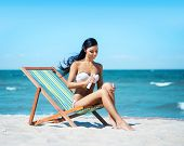 image of suntanning  - Young - JPG