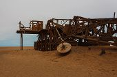 stock photo of skeleton  - Old oil extraction station abandoned from Skeleton Coast Namibia - JPG