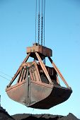 picture of coal barge  - Slackline cableway bucket with coal at river port Russia - JPG