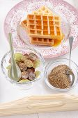 stock photo of flaxseeds  - breakfast on a serving tray with grape waffle honey spoon and milled flaxseed - JPG