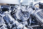 picture of turbines  - Turbo car engine showing parts and turbine dealer service workshop - JPG