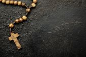 picture of prayer beads  - rosary beads on old black background - JPG