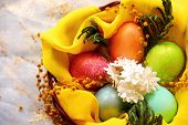 stock photo of risen  - Easter eggs in basket painted in different colors with pearly shimmer - JPG