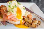 Постер, плакат: Close up of delicious eggs benedict with runny yellow yolk