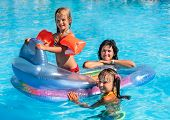 foto of swimming pool family  - Family with children in swimming pool - JPG