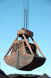 foto of coal barge  - Slackline cableway bucket with coal at river port Russia - JPG