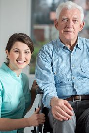 stock photo of social housing  - Image of disabled man and social welfare worker