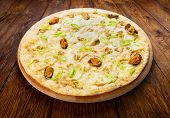 pic of leek  - Delicious seafood pizza with shrimps mussel olives and leek  - JPG