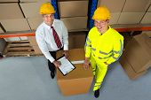 picture of warehouse  - Happy Warehouse Worker And Manager Checking Inventory In Warehouse - JPG
