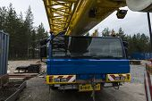 stock photo of boom-truck  - A machine with a crane for heavy industrial use - JPG