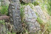 picture of stone sculpture  - Lava stone sculpture of an old man poured with water to make its design stand out - JPG