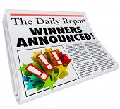 stock photo of newspaper  - Winners Announced newspaper headline presenting announcement of contest prize or award chosen and reported - JPG