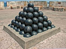 image of cannon-ball  - A photograph of cannon balls on display inside Fort San Cristobal San Juan Puerto Rico - JPG