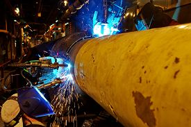 stock photo of welding  - Welding of the pipeline - JPG