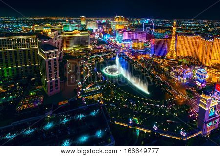 poster of The Las Vegas Strip as seen from the Cosmopolitan hotel with view onto Bellagio hotel and casino, Bellagio fountains, Paris hotel and casino, Caesars, and many others.