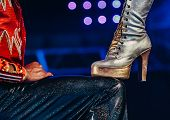 Female And Male Leg Of Cabaret Dancers Womens Feet In High Heeled Boots Carnival Dancer Legs On Danc poster