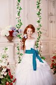 Beautiful girl model princess in the palace with flowers. Bride in a white dress. Woman in a luxurio poster