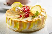 Macro Photo of Round Lemon Cheesecake Decorated with Whipped Cream, Redcurrant and Mint on Blurred B poster